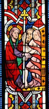 A stained glass window at St. Leonhard Church in Lavanttal, Austria (circa 1340) depicts Jesus (left) freeing lost souls from hell (right)