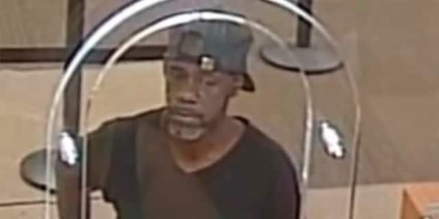 Michael Harrell, 54, robbed a U.S. Bank in Cleveland, Ohio, in July after handing a teller a note with his name on it, the FBI says. (Cleveland Division of the FBI via WJW)